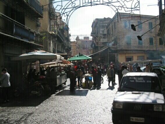 Hidden behind Palermo's 'Gucci' high street was this bustling streetmarket, selling anything from a calorie laden pizza to a half a cow. We stuck with the pizza.